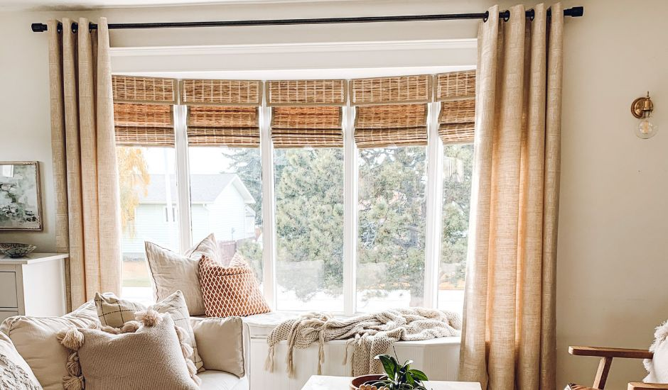 woven shades and drapery in bay window