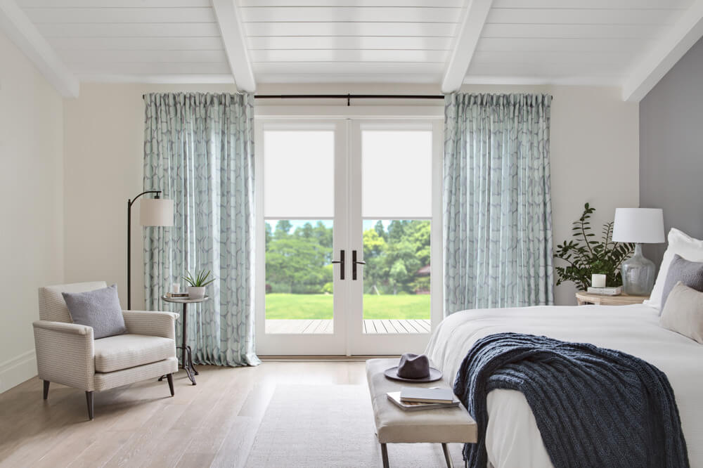 Mint Drapes and Roller Shades in Bedroom