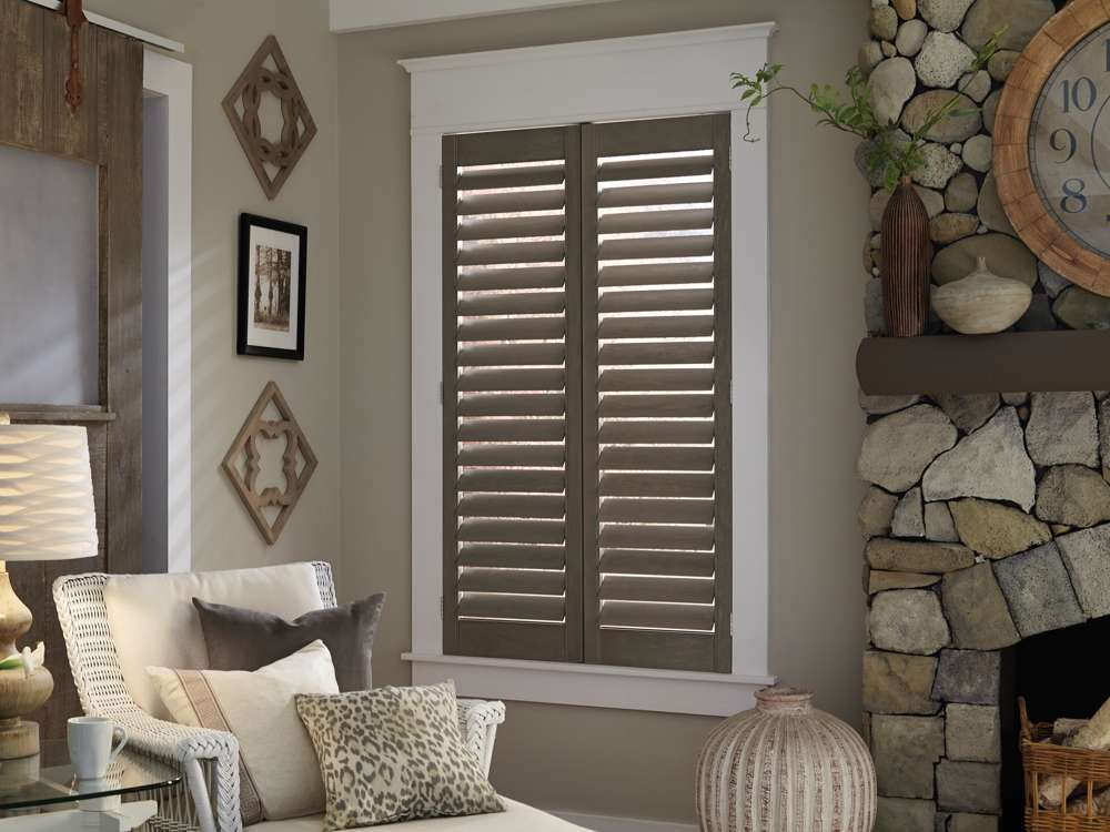 brown plantation shutters in sitting room