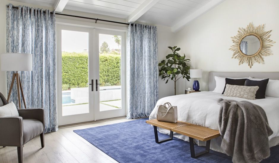 blue drapery in bedroom