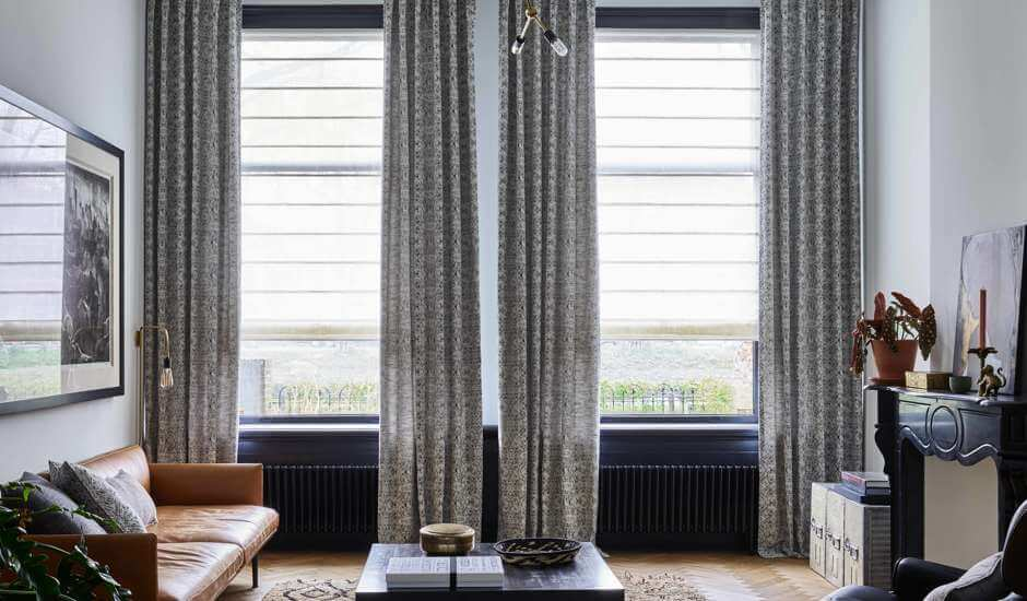 White Roman Shades and Gray Draperies in Living Room