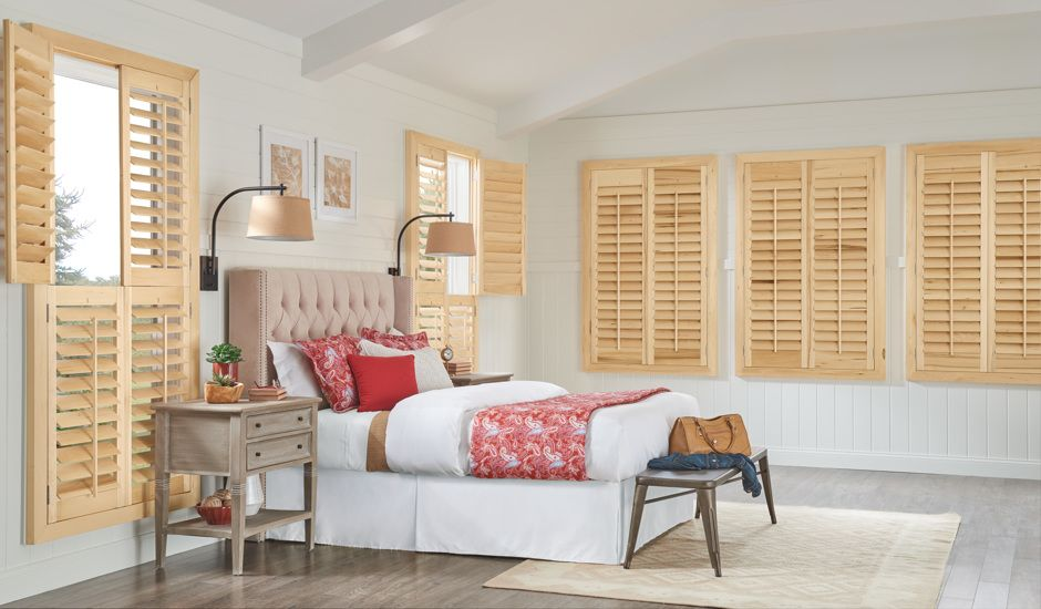 wood shutters in bedroom