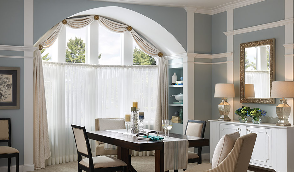traditional-dining-room-arched-window-drapes-valance