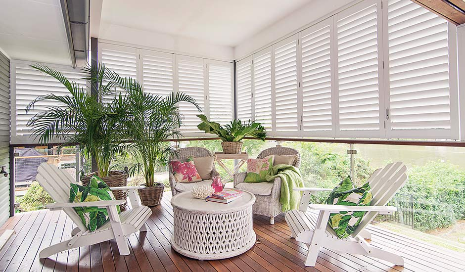 white-tropical-sunroom-wood-shutters